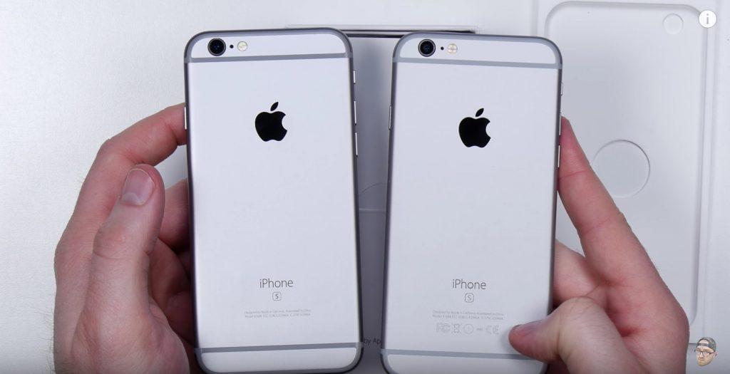 Kiri palsu, kanan asli. Perhatikan logo dan simbol yang hilang di iPhone palsu